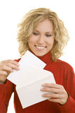 Opening a letter. Blonde young woman opening a letter Royalty Free Stock Images