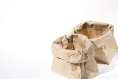 Opening lunch bags. Opening brown paper  lunch bags on white background Stock Photo