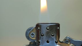 Opening the metal lighters and flames stock footage