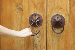 Opening the old door Stock Images