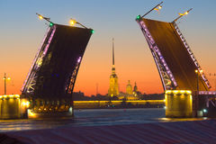 Opening the Palace Bridge on Neva river in St. Petersburg during the white nights. Peter and Paul fortress on the background stock video
