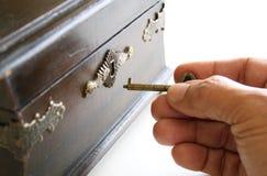 Opening Pandoras box. Hand opening secret box with key Stock Photo