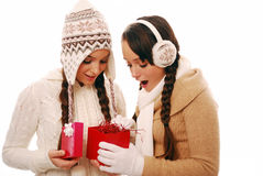 Opening present. Friends opening gift box together surprised at whats inside, over white isolated background Royalty Free Stock Photo
