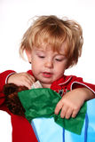 Opening Presents. Young boy opening a present Stock Image