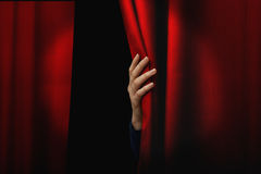 Opening red curtain. Girl open a red curtain royalty free stock photo