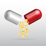 Opening red medical capsule Stock Image