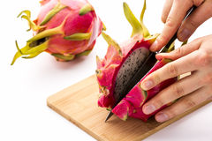 Opening A Ripe Dragonfruit With A Longitudinal Cut Royalty Free Stock Photo