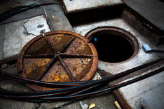 Opening rusty manhole cover Stock Images