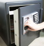 Opening the Safe. Hand pulling open the door of a personal safe Royalty Free Stock Photography