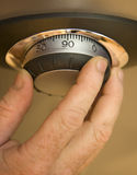 Opening a Safe. Opening a combination lock on a safe Royalty Free Stock Images