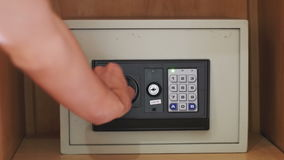 Opening a Safe with Numerical Keypad stock footage