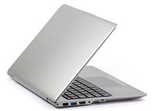 Opening silver modern lightweight laptop Royalty Free Stock Photography