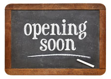 Opening soon blackboard sign Stock Photo