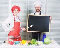 Opening soon. Hiring staff. Woman and man chef hold blackboard copy space. Job position. Cooking delicious meal recipe. Cooking menu for today. List royalty free stock photo