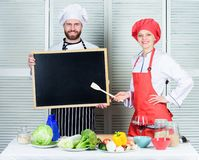 Opening soon. Hiring staff. Woman and man chef hold blackboard copy space. Job position. Cooking delicious meal recipe. Opening soon. Hiring staff. Woman and men royalty free stock photo
