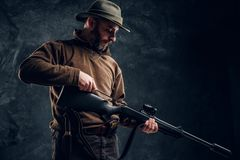 Opening of the spring hunting season. A man cleans rifle barrel stock photo