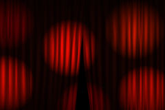 Opening stage curtains with bright projectors Royalty Free Stock Photo