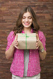 Opening surprise. Beautiful woman opening a gift box Royalty Free Stock Photos