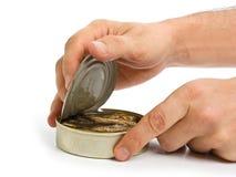 Opening tin royalty free stock photo
