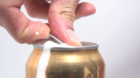 Opening tin of beer stock video