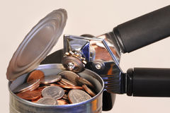 Opening tin can of money Royalty Free Stock Photo