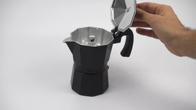 Opening the top of a stovetop expresso coffee maker isolated stock footage
