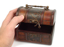 Opening the Treasure Box. Male hand opens old miniature treasure box isolated over white background Royalty Free Stock Photography
