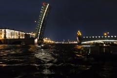 Opening a  Troitsky drawbridge. Neva River, Saint Petersburg. August 2017. Night photography Stock Photos