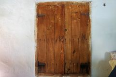 Wooden old window in village house royalty free stock photography