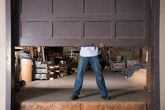 Opening warehouse door Stock Image