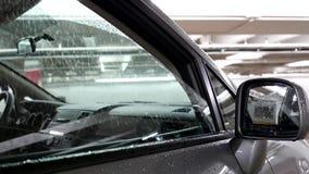 Opening window of car inside parking lot stock video