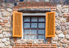 Opening windows from the house made from rocks stock images