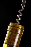 Opening a wine bottle. With corkscrew, isolated on black Stock Photos