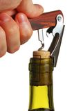 Opening a wine bottle. With corkscrew, isolated on white Royalty Free Stock Photos