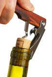 Opening a wine bottle. With corkscrew, isolated on white Stock Image