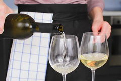 Opening a wine bottle Stock Photos