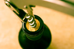 Opening a wine bottle Royalty Free Stock Photography