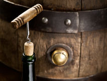 Opening of a wine bottle with corkscrew. Royalty Free Stock Photo