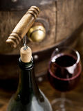 Opening of a wine bottle with corkscrew. Stock Photography