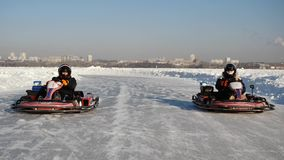 Opening of the winter season - free open auto show - winter carting on the snow track. karting in the winter stock photos