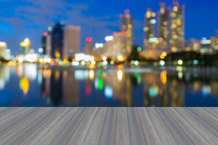 Opening wooden floor in Bangkok city park water front Stock Image