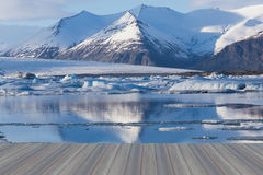 Opening wooden floor, Frozen lake in south of Iceland Stock Photo