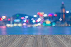 Opening wooden floor with Hong Kong blurred bokeh city lights at night Stock Photography