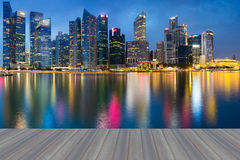 Opening wooden floor, Singapore Marina Bay Business District. Water reflection Stock Images