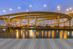 Opening wooden floor, Suspension Bridge across the river. At twilight, The Industrial Ring Road Bangkok, Thailand Stock Photo