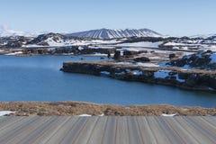Opening wooden floor, Valcano mount and lake in Myvatn Winter landscape Stock Photo