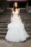 Mooie jonge vrouw in huwelijkskleding Royalty-vrije Stock Afbeelding