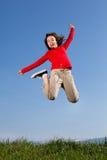 Openlucht springen van het meisje stock afbeelding