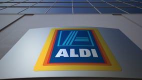 Openluchtsignage raad met Aldi-embleem De moderne bureaubouw Het redactie 3D teruggeven Stock Foto's
