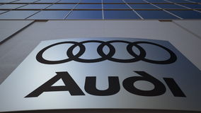 Openluchtsignage raad met Audi-embleem De moderne bureaubouw Het redactie 3D teruggeven Stock Afbeelding